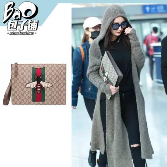 杨幂拿Gucci男士手拿包-盘点23款女明星街拍爱用的爆款包包图片