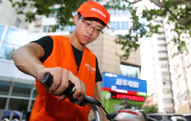 共享单车运维员:科技加体力塑造城市新卫士