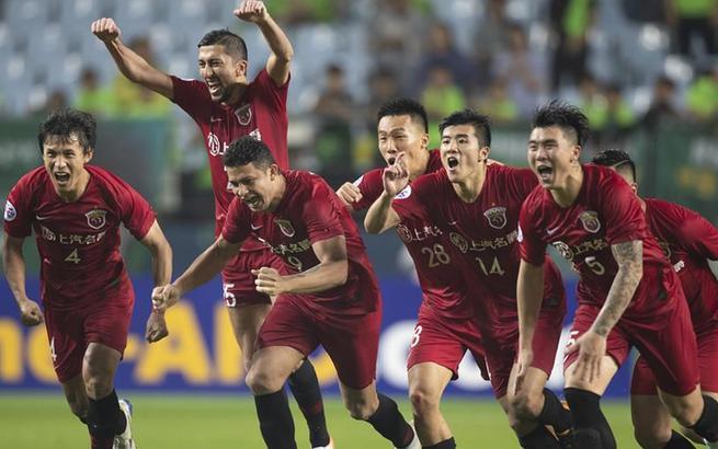 足球——亚冠:上海上港胜全北现代晋级八强